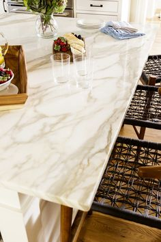 polished calacatta gold marble kitchen island countertop - SCS Design, LLC - Sophia Shibles Interior Design