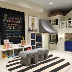 Alice Lane Home Collection | Kids' playroom with black, white and blue accents and playhouse.