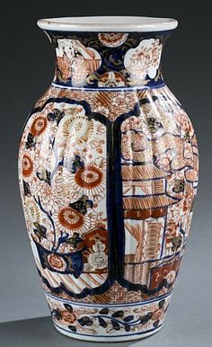"A Japanese Imari porcelain vase. 19th century. With blue, orange, and gold interior and floral designs. Drilled for use as lamp. 12 1/2""h."