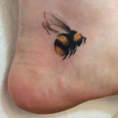 21 Cutest Bumble Bee Tattoo Designs That Will Catch Your Eye - Home of Be. - 21 Cutest Bumble Bee Tattoo Designs That Will Catch Your Eye – Home of Best Tattoos - Bumble Bee Tattoo, Honey Bee Tattoo, Heel Tattoos, Foot Tattoos, Body Art Tattoos, Ankle Tattoos, White Ink Tattoos, Tattoo Designs Foot, Tattoos Skull