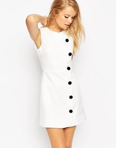 Mini dress with button detail reminding me of the Austin Powers days  $81