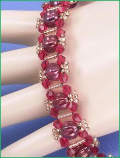 """Jewelry is made with small beads. Some are glass or stone. Adult supervision is recommended. This bracelet is made with Miyuki 11/0 gold silver lined glass seed beads along with 4mm dark red Chinese bicone glass crystal beads and is accented with 8mm siam red vega melon glass beads and also hooks with a trailer hitch or snap clasp. Measures approx. 7 3/4"""" long (including clasp) by 5/8"""" wide and is a design pattern from: Deborah Roberti. Priced at only $24.00 with """"FREE SHIPPING."""""""