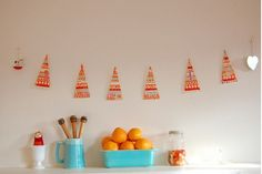 Create a Christmas-tree garland. | 38 Fabulous DIY Christmas Trees That Aren't Actual Trees