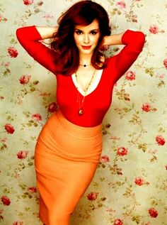 christina Hendricks in orange just makes me want to peel her clothes off of her and get all her juices.