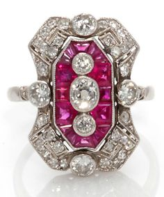 An art deco ruby and diamond ring, French, circa 1925;   featuring calibré-cut rubies accenting oval, old European, single and rose-cut diamonds; reference no. 16497; with French assay mark; mounted in platinum; size: 6. Via Bonhams.