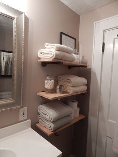 Restoration Hardware knock off shelf for the bathroom. Simple diy