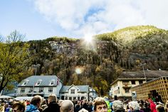 2013.10.30 - People gathered during the official opening of sun mirrors in Rjukan, Norway. Residents of a remote village nestled in a steep-sided valley in Norway can enjoy winter sunlight for the first time ever thanks to the giant mirrors. (Soerboe Krister/AFP/Getty Images)