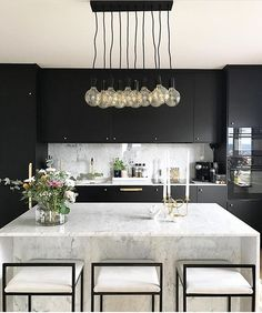 This lighting is perfect for a modern kitchen. This lighting is perfect for a modern kitchen. This lighting is perfect for a modern kitchen. This lighting is perfect for a modern kitchen. Black Kitchen Cabinets, Black Kitchens, Luxury Kitchens, Home Kitchens, White Cabinets, Kitchen Black, French Kitchens, Marble Kitchen Countertops, Minimal Kitchen