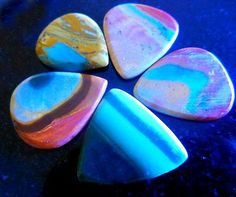 Generally speaking, gemstone guitar picks are usually associated with luxury and things like that. The first thing that you will notice about a stone guitar pick is how good looking it is. http://www.ironageaccessories.com/Premium-Guitar-Plectrums-s/100.htm