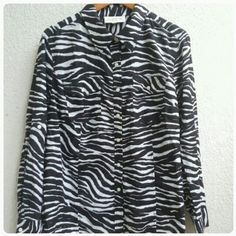 ❄ Sale ❄ Zebra Collared Button Down Cute zebra pattern collared button down.. 100% cotton.. Front pockets.. Note slight blue pen mark towards the bottom of the shirt.  Thinner lighter weight fabric 100% cotton Great to excellent condition. ✅Bundles up to 5 lbs packaged Jones New York Tops Button Down Shirts