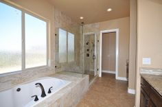 Soaker tub with large window