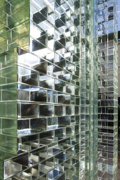 Solid glass bricks were individually cast and crafted by Poesia in Resana, near Venice. Research undertaken by the Delft University of Technology, in partnership with engineering firm ABT and contractor Wessels Zeist, led to the development of structural solutions and fabrication techniques, with the use of a high-strength, UV bonded, transparent adhesive from Delo Industrial Adhesives in Germany to cement the bricks together without the need for a more traditional mortar. Chanel Store, Glass Blocks, Brick Building, Building A House, Amsterdam Houses, Amsterdam Netherlands, Architrave, Architect Magazine, Crystal Palace