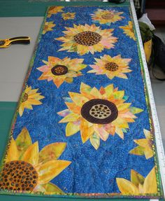 https://flic.kr/p/8NUkeB | Sunshine of My Life | This weekend is the Champlain Valley Quilter's show at Shelburne Farms. This is a picture of my entry. It's hard to see in the picture, but I spent days and days beading it. Because of the way I took the picture, you're actually looking at it upside down.