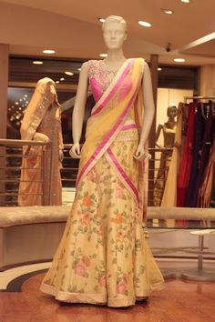 Yellow and Pink Floral Lehenga Fabric: Net and Silk Embroidery: Mirror, zari, and stone work  For more information please contact sales@sahil.com and visit us at www.sahil.com