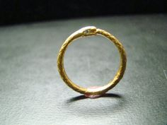 Year of the Snake // 14k gold thin snake band with diamond eyes. $260.00, via Etsy.