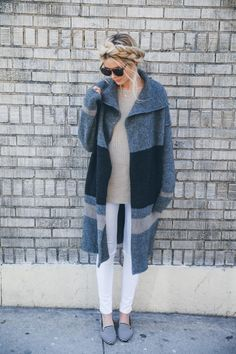 Amber Fillerup Clarke looked perfectly winter chic in white jeans, loafers, and an oversized cardigan.