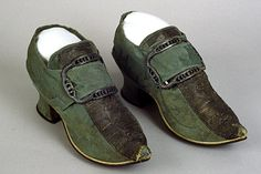 Pair of woman's shoes, England, 1720-1730, later alterations 1740-1760. Green/grey silk damask; high Louis heels and with pointed toes.