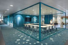 On display - glass partitioned meeting room. Very popular and on trend in the office design world!