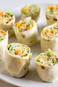 Vegetable Tortilla Roll Ups. Delicious appetizer with cream cheese filling spread on tortillas, topped with veggies and cheese. Slice and serve. Just like veggie pizza! Veggie Roll Ups, Veggie Pizza, Pizza Roll Up, Appetizer Recipes, Appetizers, Roll Ups Recipes, Tea Recipes, Healthy Recipes, Roll Ups Tortilla