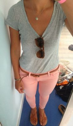 Grey V-neck and coral pants.