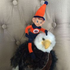 Cam, our Auburn Elf on the Shelf, gets around in the best way possible - by riding on our stuffed Bald Eagle! Find these Elf accessories and more for your #AuburnChristmas at auburnart.com!