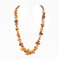 """""""Natural #Amber Pebbles Necklace Item No. AM00774A01 $118.29 This beautiful 100% Natural Amber Pebbles Necklace is comprised of multi colors amber stones, which were tumble-polished by the Baltic Sea in Russia. The stones gradually range in size from about 3/8"""" to 1 1/4"""", which are individually knotted allowing you to see more of each pebble. Each strand is hand strung so there are no two alike. Here we show one of the strands to generalize the presentation of these necklaces. Amber Necklace, Amber Jewelry, Beaded Necklace, Amber Heart, Amber Stone, Baltic Sea, Big And Beautiful, Strands, Handmade Necklaces"""