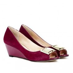 Cranberry suede buckle wedges.