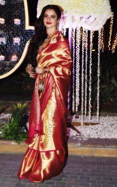 Bollywood ageless beauty Rekha in Kanjeevaram silk saree at Manish malhotra's niece Riddhi malhotra-Tejas talwalkar wedding reception in Mumbai. It was a r