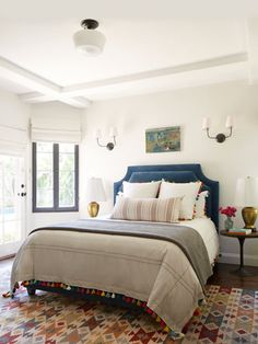Here, the rug does the heavy lifting, with neutrals (like the white walls and bedding) nearly everywhere else except the bedding's sweet tassel trim.