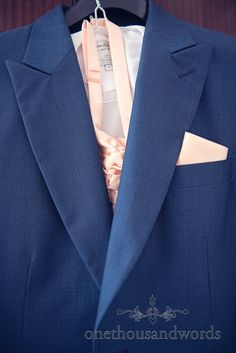 Grooms blue wedding suit on morning of Bournemouth Hotel Wedding. Photography by one thousand words wedding photographers