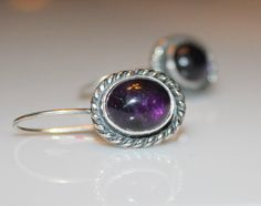 Just in time for the Feb birthday girl - gorgeous natural Amethyst cabochon and silver earrings by MyFascinationStreet on Etsy!