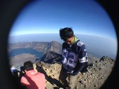 standing in the summit wearing dallas cowboys jersey..
