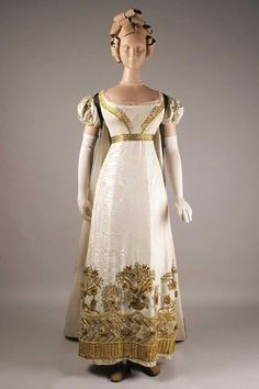 Court dress with detachable train, England, ca. 1810-1825  Ivory moiré silk faille dress with gold embroidery and green velvet train with gold embroidery. Kent State University Museum   https://kentstateuniversitymuseum.wordpress.com/2014/09/26/gold-embroidery-on-a-court-dress-and-train/