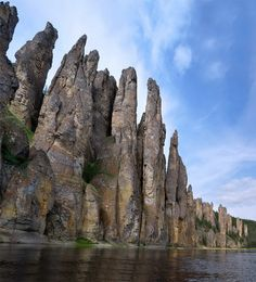 The giant stone colonnades of Lena Pillars Nature Park line the banks of the Lena River in the Sakha Republic, also known as Yakutia. Isolated from each other, the pillars soar to heights of 100 meters or more than 328 feet, and are also rich in fossils. They formed by freeze-thaw action over the millennia due to the area's extreme changes in temperatures.