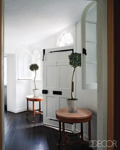 Room/Style: Foyer, Country    Notes: In an Ossining, New York, home, the original fir floor in the entry hall has been stained a darker shade.     Photographer: William Waldron   Designer: James Shearron