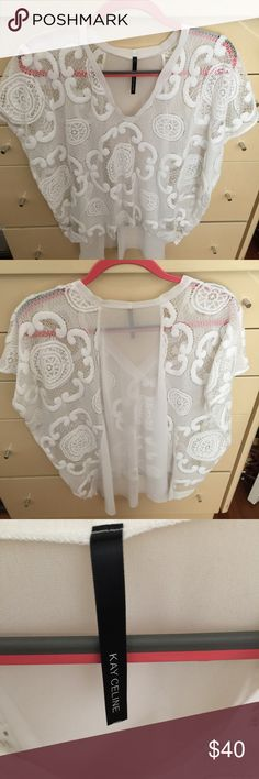 Beautiful top! Wear it with a tank top or just your bra and it's very sexy! Never worn! Kay Celine Tops Tunics