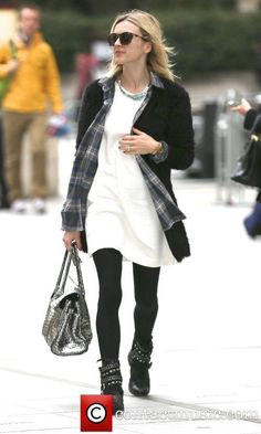 Fearne Cotton arriving at the BBC Radio 1 studios wearing a white dress, checkered shirt, blakc leggings and a black coat