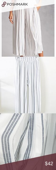 Smocked Waist Cullotes A light wooven culottes feauturing a striped pattern, smocked waist, flowy wide legs , and on-seam pockets.  •Matching top available.   •Rayon  •Hand wash cold  •Imported  📲Insta @ shopyourstrulyadri  🌐 online shop - www.yourstrulyadri.com Pants Wide Leg