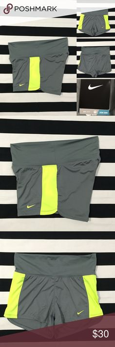 """NWT [Nike] DRI-FIT women's athletic shorts szXL NWT [Nike] DRI-FIT women's athletic shorts szXL •🆕listing •NWT- new with tags condition •grey/neon yellow •fold over waistband with inside waist pocket •length/inseam 3"""" •material polyester •Note: model in photo wearing szS shorts, shorts in this listing are XL •Offers are welcomed using the offer feature or bundle for the best discount Nike Shorts"""
