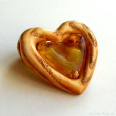 Amber heart:  https://www.majzner.eu/en/carved/1415-pendant-1465.html