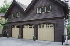 detached Craftsman garage with container plants