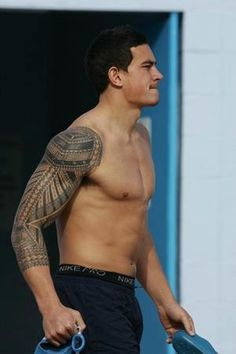 tribal arms tattoos for men