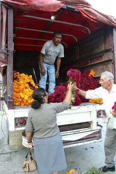 Unloading flowers on one side of Mercado Juarez  Monterrey, Nuevo leon