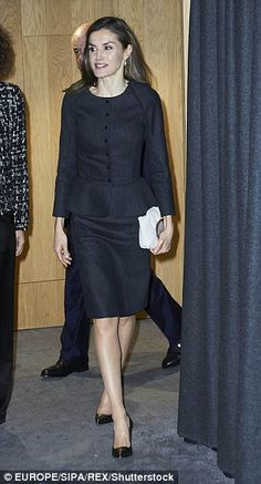 The royal brightened up her outfit with a  cream clutch bag decorated with agate detailing...