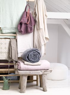 Towels and linens stored on a step stool
