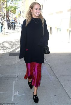 A cosy cover up: Suki Waterhouse sported a long cosy sweater and brightly…