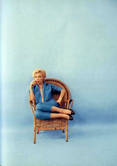 Boldly sits pretty Marilyn Monroe but there is something more that this photo tells than a pair of pants clinging in blue than only fem...