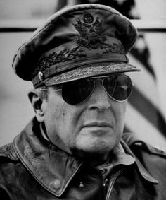 A close up of General MacArthur allowing a better view of his specially designed and heavily decorated military cap.The Hero of the Philippines.