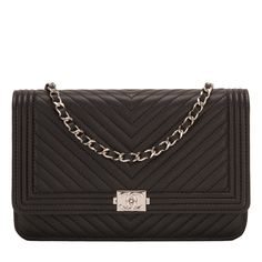 Chanel chevron quilted Boy Wallet on Chain (WOC) of black lambskin leather with silver tone hardware. AVAILABLE NOW For purchase inquiries, Please Contact: Email: info@madisonavenuecouture.com I Call (212) 207-4572 I WhatsApp (917) 391-2281 Direct Message on Instagram: @madisonavenuecouture Guaranteed 100% Authentic   Worldwide Shipping   Bank Transfer or Credit Card