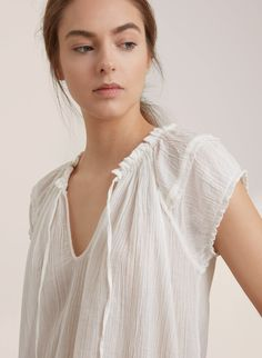 GOLDEN by TNA PETILLI BLOUSE | Aritzia